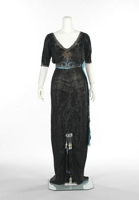 Doeuillet, Georges. Evening dress with black net, blue satin and taffeta moiré and ornamentation, 1910 - 1913. Copyright the Metropolitan Museum of Art.