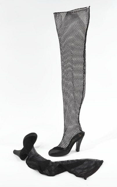Levine, Beth. Stocking shoes. Black satin silk and nylon fishnet mesh, size 4B. Part of the Brooklyn Museum Costume Collection at the Metropolitan Museum of Art.
