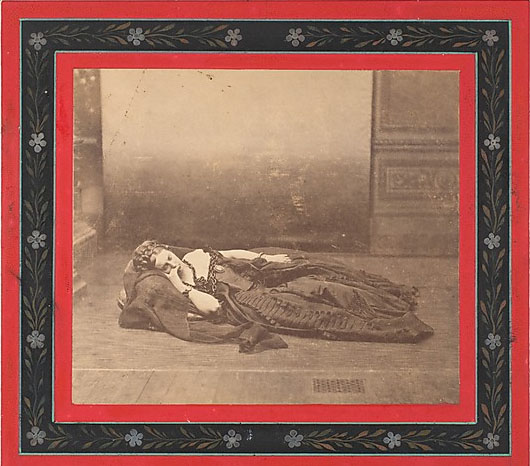 Pierson, Pierre-Louis. La Comtesse Reclining in Dark Dress with Chain Around Neck, 1861-65. Albumen silver print from glass negative, 10.2 x 12.0 cm. Accession number 1975.548.257 at The Metropolitan Museum of Art.